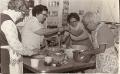 Old photo of people cooking